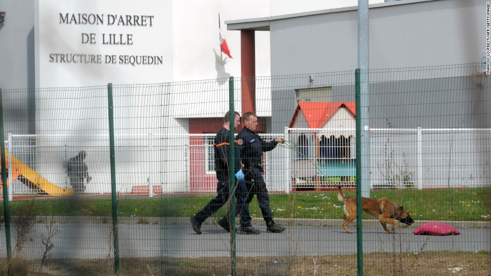 Policemen search for clues in the prison yard. Faid, who faced a heavy sentence in the 2010 death of a policewoman, used explosives to blast through five prison doors.