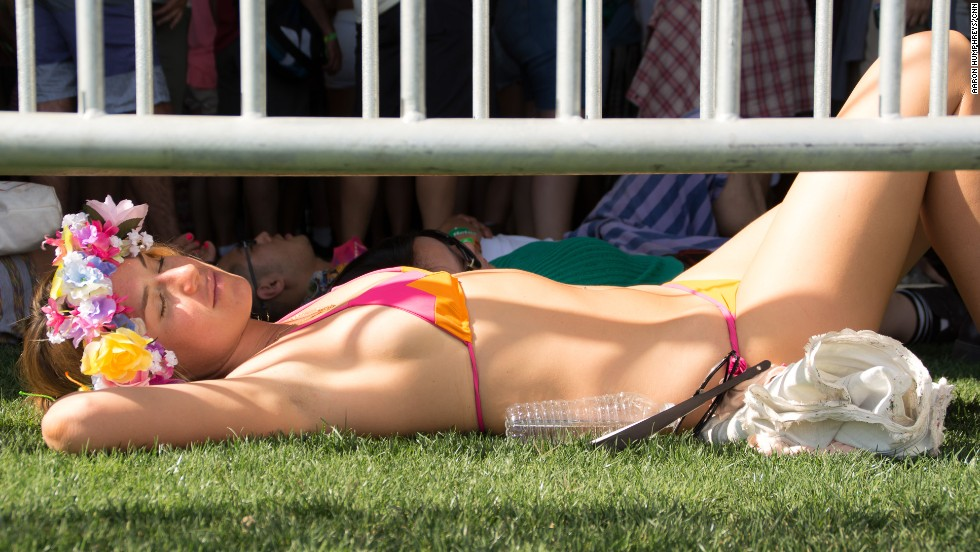 A bikini-clad festival-goer chills out during Polica's set in the Gobi tent on April 12.