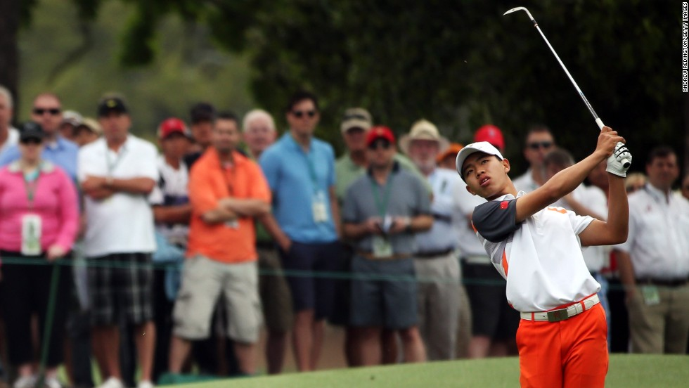 Guan Tianlang of China hits his third shot on the eighth hole.