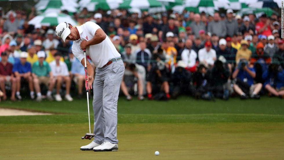 Adam Scott of Australia makes a birdie putt on the 18th hole.