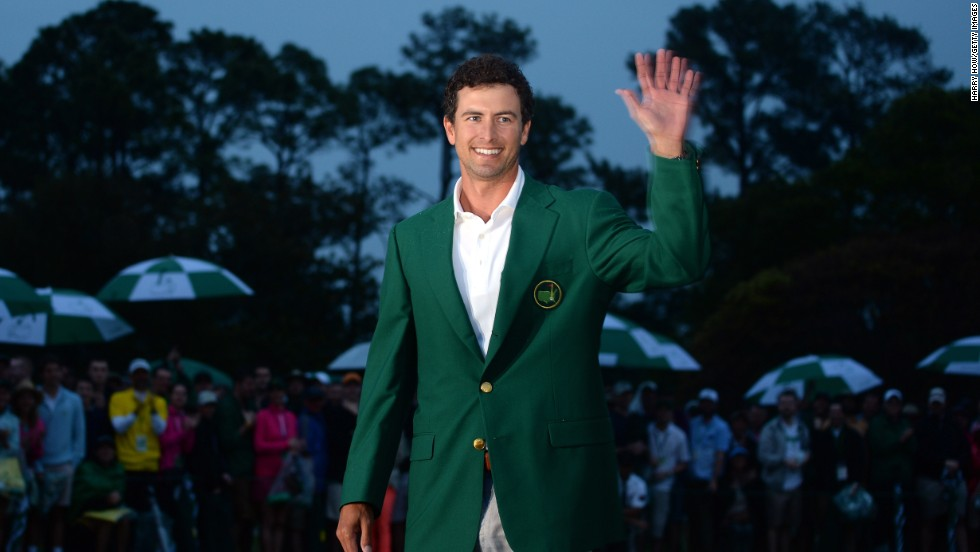 "Adam Scott of Australia smiles while wearing the green jacket after winning the 2013 Masters Tournament at Augusta National Golf Club in Augusta, Georgia, on Sunday, April 14. Scott captured golf's most prestigious event in an oh-so-close sudden-death playoff with Angel Cabrera. Click through to see all the shots from the fourth day and <a href=""http://www.cnn.com/2013/04/13/golf/gallery/masters-round-three/index.html"" target=""_blank"">look back at the third round</a>."