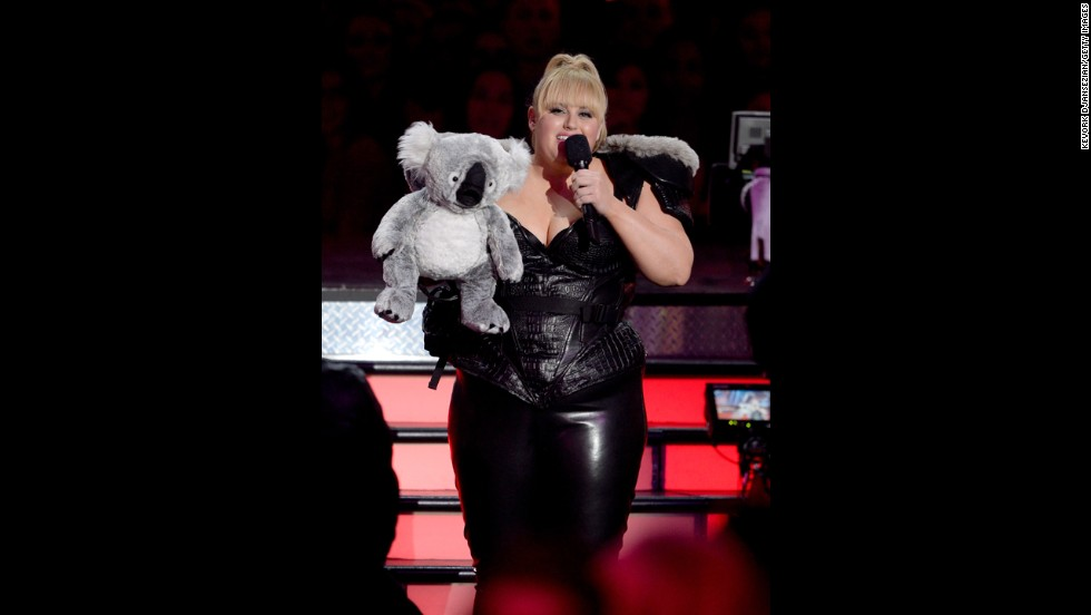 "Host Rebel Wilson, who hails from Australia, injects some Down Under flavor into Sunday's proceedings. <a href=""http://www.mtv.com/videos/misc/898751/rebel-wilson-and-her-koala-chlamydia-scope-out-the-crowd.jhtml"" target=""_blank"">She brings out a stuffed koala</a> and uses its ""excellent X-ray vision"" to play pranks on celebrities Quvenzhané Wallis and Chris Evans."