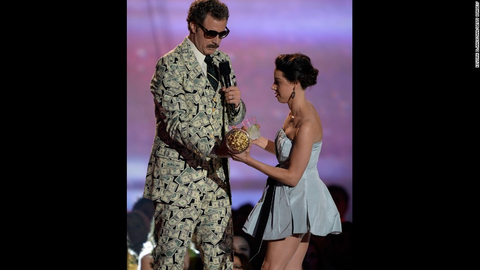 "Aubrey Plaza provides the<a href=""http://marquee.blogs.cnn.com/2013/04/15/aubrey-plaza-stage-crashes-mtv-movie-awards/""> head-scratching moment of the night</a> when she hops up on the stage and tries to take Will Ferrell's Golden Popcorn statue."