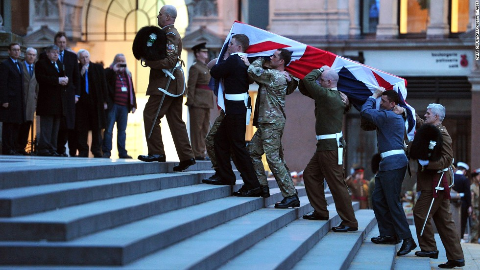 Bearer Party from the three military services carry a coffin up the steps of St Paul's Cathedral during the rehearsal for the ceremonial funeral.
