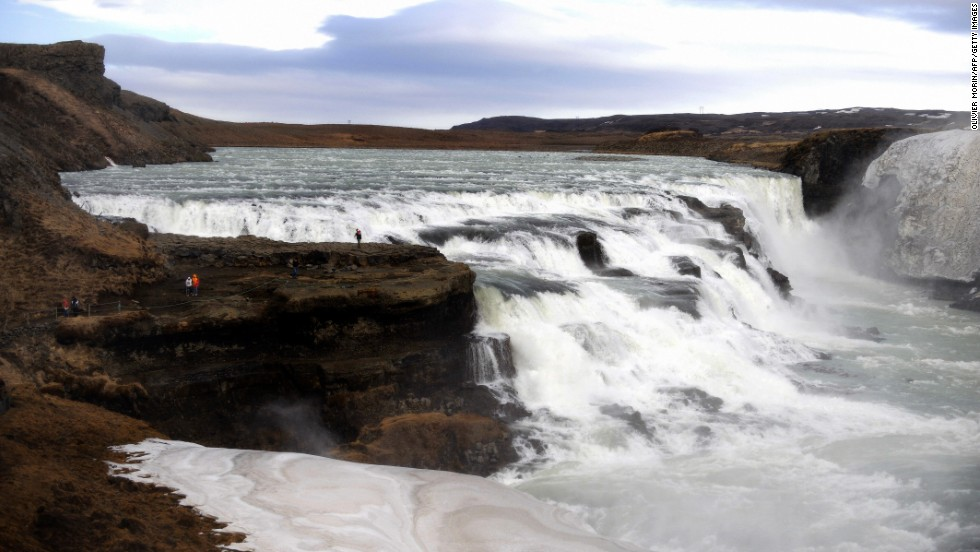 "Iceland's Gullfoss, or ""Golden Falls,"" get their name from the brownish glacial water that drops down a huge natural staircase in the River Hvita."
