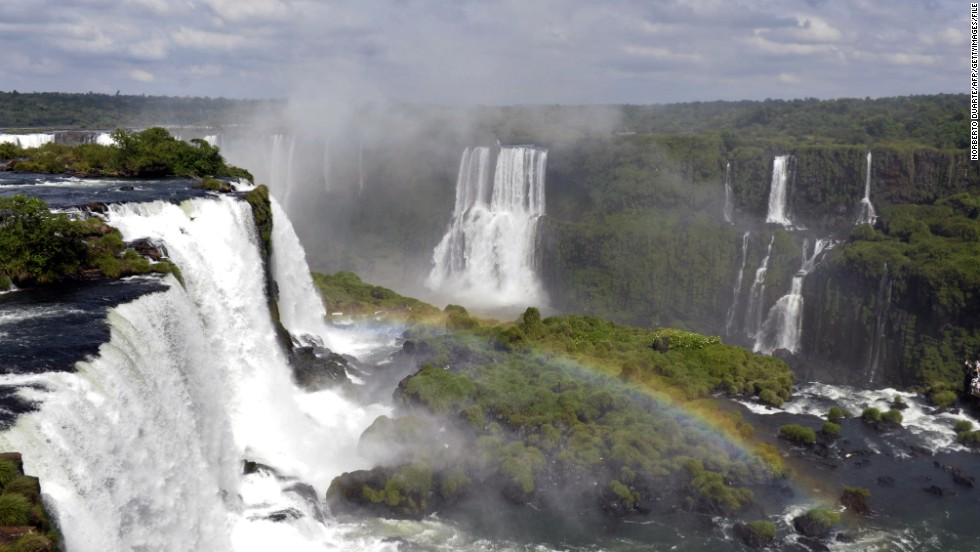 Nearly three times wider than Niagara Falls, the immense Iguacu Falls on the Argentina-Brazil border resemble a long horseshoe.