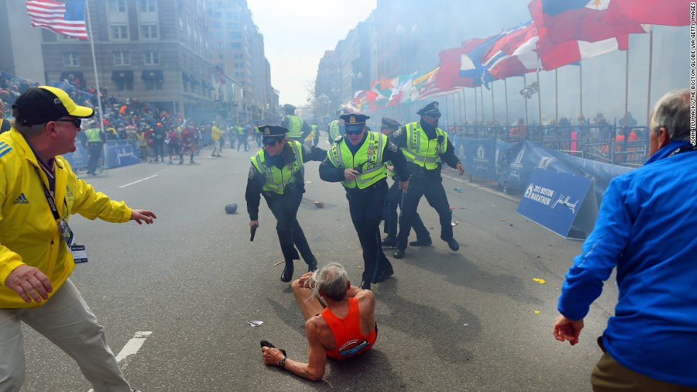 "The first explosion knocked down<a href=""http://piersmorgan.blogs.cnn.com/2013/04/15/bill-iffrig-subject-of-iconic-boston-globe-photo-the-shock-waves-hit-my-whole-body-my-legs-just-started-jittering-around-i-knew-i-was-going-down/""> 78-year-old runner Bill Iffrig</a> at the finish line. He got up a few minutes later and finished the race."