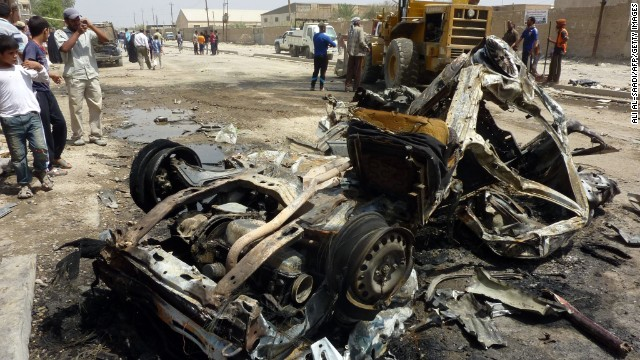 The remains of a vehicle is seen following an explosion in the al-Obaidi neighborhood, east of Baghdad, on April 15, 2013.
