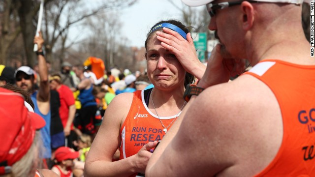 BOSTON, MA - APRIL 15:  A runner reacts near Kenmore Square after two bombs exploded during the 117th Boston Marathon on April 15, 2013 in Boston, Massachusetts. Two people are confirmed dead and at least 23 injured after two explosions went off near the finish line to the marathon.  (Photo by Alex Trautwig/Getty Images)