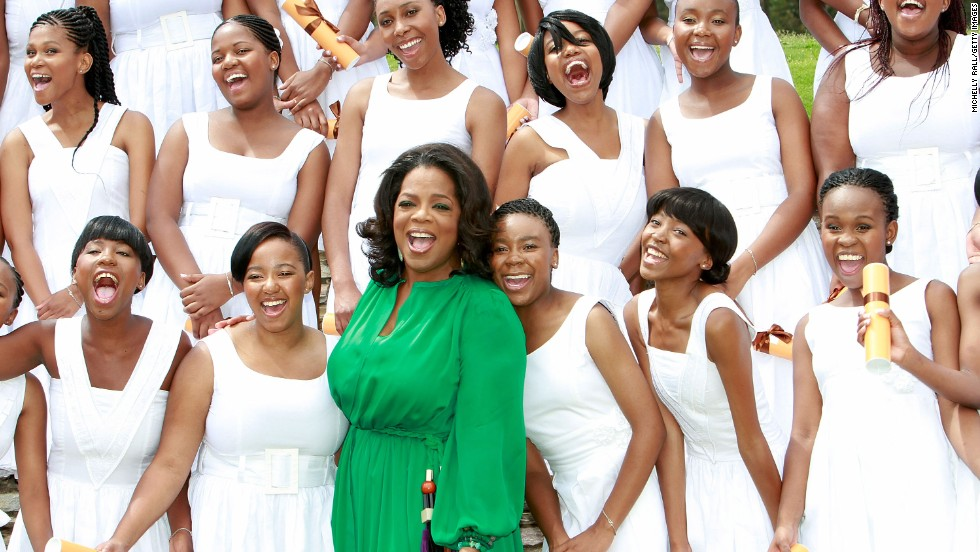 Oprah Winfrey poses with the graduates of the school she funded, the Oprah Winfrey Leadership Academy for Girls in Henley on Kilp, South Africa, in January 2012.