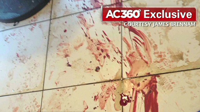 Witness: Pool of blood in middle of store