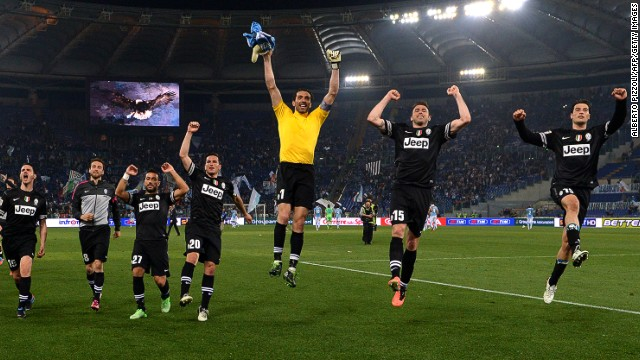 Juventus' players celebrate a decisive victory at Lazio that extends their lead at the top of Serie A to 11 points