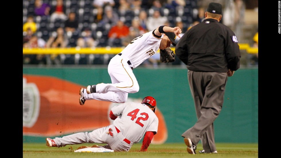 Clint Barmes of the Pittsburgh Pirates turns a double play in the fifth inning against Pete Kozma of the St. Louis Cardinals at PNC Park in Pittsburgh.