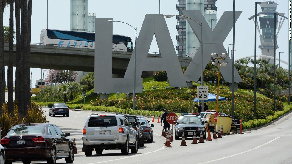 Cars stop at a checkpoint at Los Angeles International Airport on Monday.
