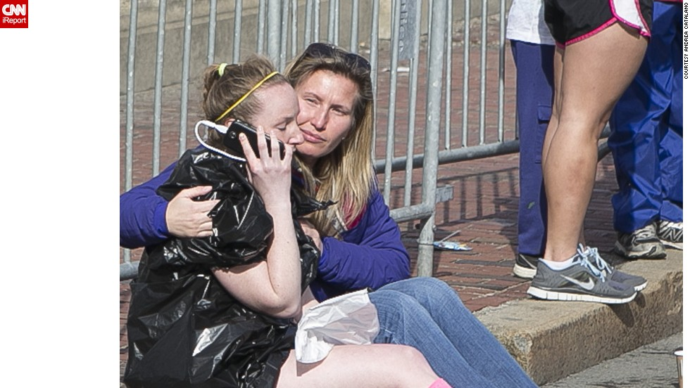 "As police led runners down a secure area, <a href=""http://ireport.cnn.com/docs/DOC-957434"">Catalano saw a woman run up crying uncontrollably.</a> She was wondering if her husband, who was at the finish line, was OK. Someone provided her with a phone, and she was able to contact her husband and make sure he was safe."
