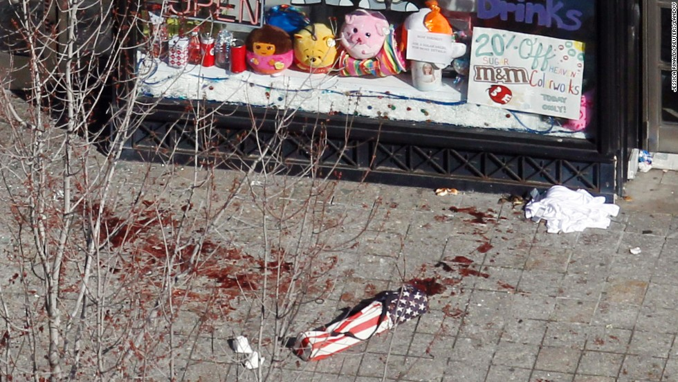 Blood is visible on a sidewalk in front of a Boston store on April 16.