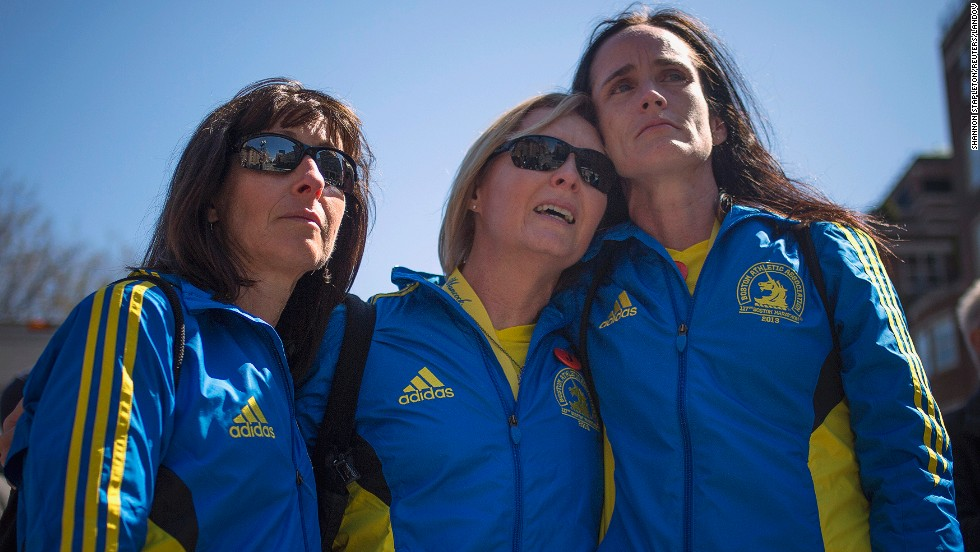From left, Boston Marathon runners Tammy Snyder, Diane Deigmann and Lisa Kresky-Griffin embrace at the barricaded entrance to Boylston Street on April 16, 2013.