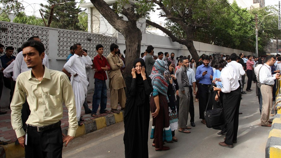 People evacuate buildings in Karachi, Pakistan, following a powerful earthquake near the border with Iran on Tuesday, April 16.