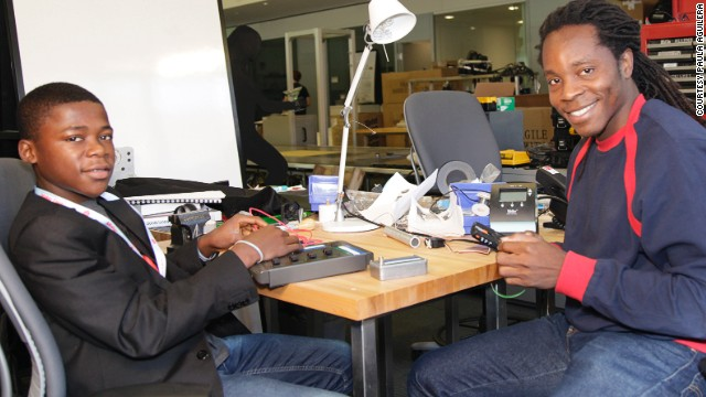 David Sengeh, right, mentoring Kelvin Doe, a 15-year-old Sierra Leonean who built a radio station from scrap materials.