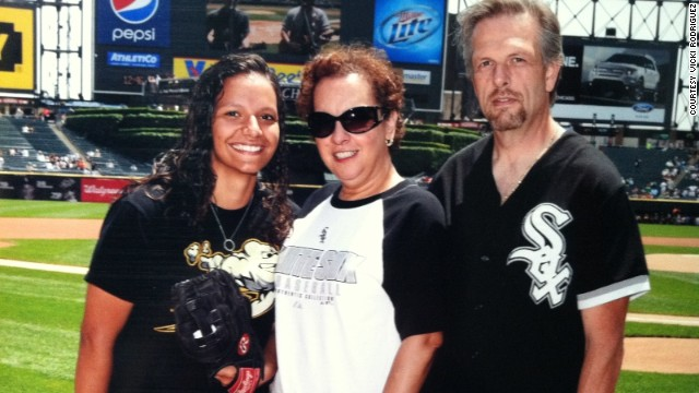 Vicki Rodriguez and her former foster parents, Linda and Ron Nemecek, at a White Sox game.