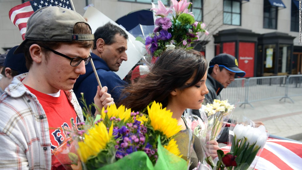 People walk along the barricade at Boylston Street on April 16, 2013.