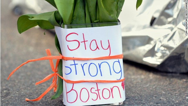 Flowers  are left on Newbury Street, a few blocks from where two explosions struck the Boston Marathon finish line.