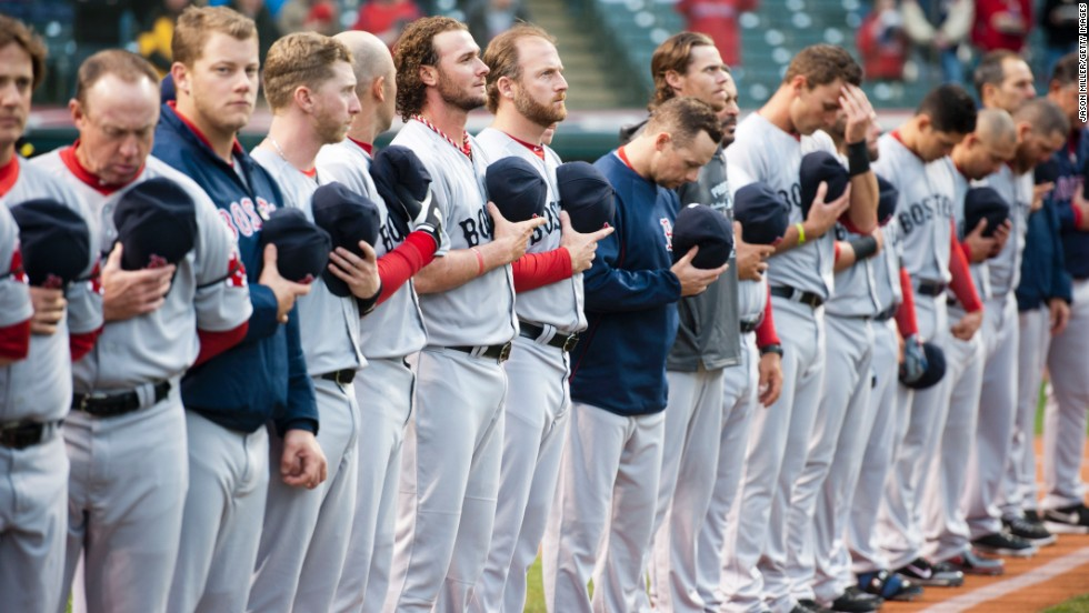 Members of the Boston Red Sox observe a moment of silence before their Major League Baseball game in Cleveland on April 16, 2013.