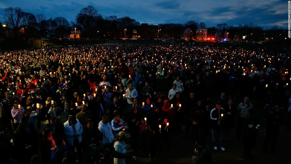 "On Tuesday, April 16, a vigil was held at Boston's Garvey Park for 8-year-old bombing victim <a href=""http://www.cnn.com/2013/04/16/us/boston-boy-killed/index.html"">Martin Richard</a>. The other victims were <a href=""http://ac360.blogs.cnn.com/2013/04/16/remembering-bombing-victim-krystle-campbell/?iref=allsearch"">Krystle Campbell</a>, a 29-year-old restaurant manager from Medford, Massachusetts, and <a href=""http://www.cnn.com/2013/04/17/us/boston-marathon-student-victim/index.html"">Lingzi Lu</a>, a 23-year-old Chinese national attending graduate school at Boston University."