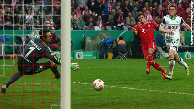 Mario Gomez fires home as Bayern Munich continued their march towards the German Cup title