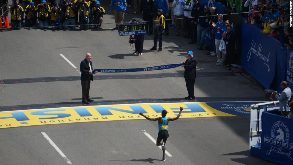 Ethiopian runner Lelisa Desisa, who won the men's marathon, reaches the finish line.