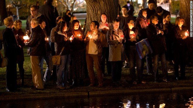 Mourners gather on the edge of the pond in the Boston Public Gardens for a candlelight vigil for victims of the bombings.