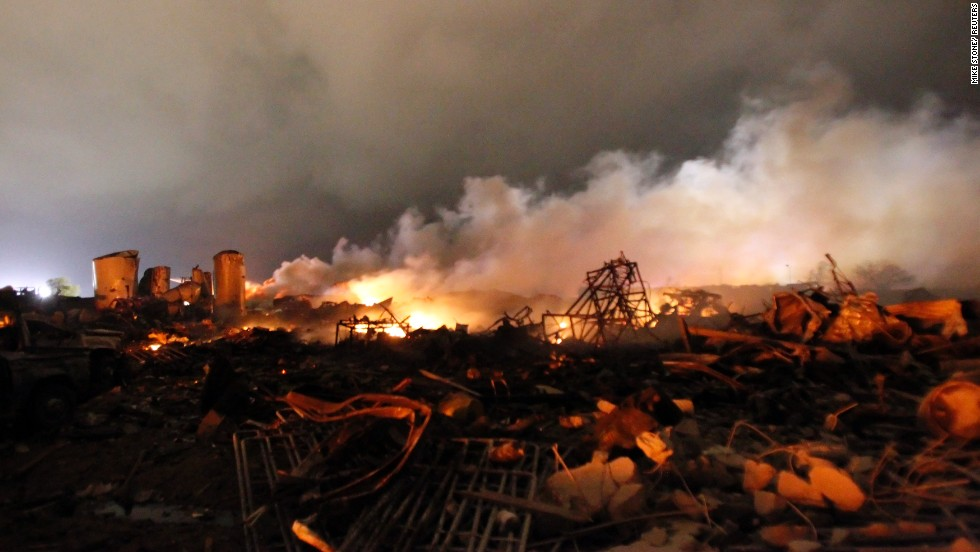 Remains of the fertilizer plant burn in the early morning after the explosion.