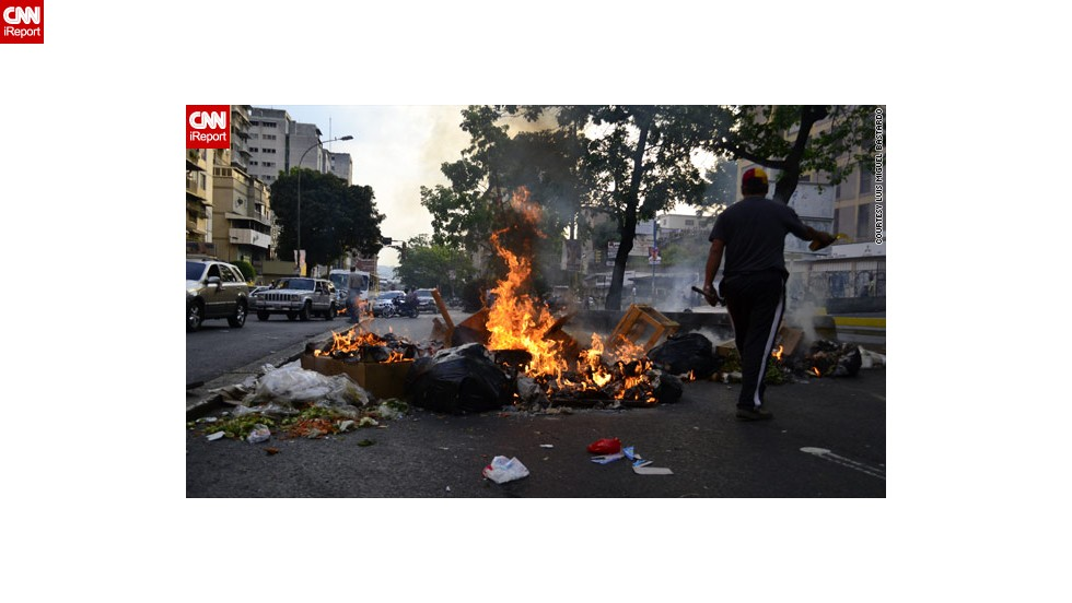 "Protests have rocked Venezuela following Sunday's election, apparently won by the late president Hugo Chavez's designated successor, Nicolas Maduro. This image from <a href=""http://ireport.cnn.com/docs/DOC-957922"">Luis Miguel Bastardo</a> shows burning trash and tires on a Caracas Street."