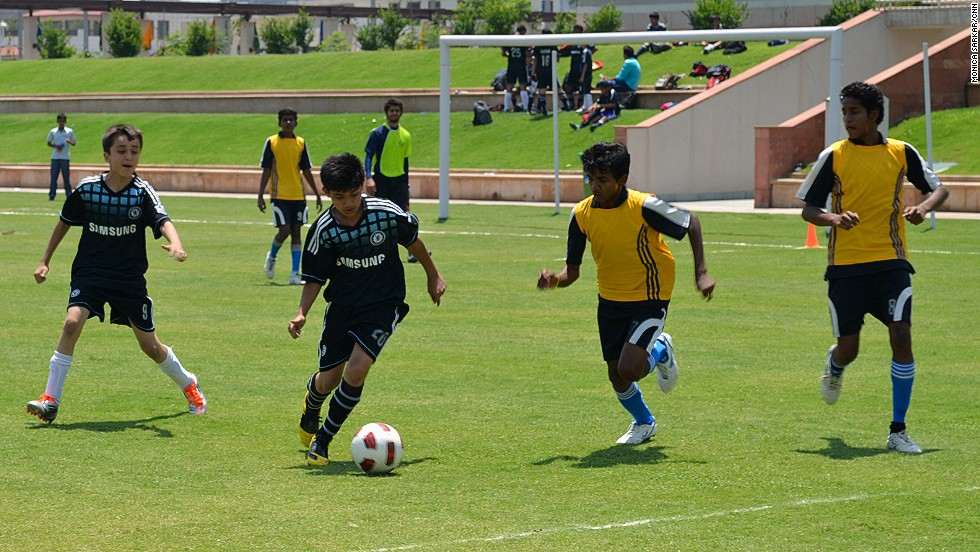 Young, aspiring footballers play a match at the Baichung Bhutia Football School at the Jaypee Sports Complex, Greater Noida, New Delhi in May 2012. Many youngsters are avid supporters of European and South American teams, but few dream of playing in their home country of India.