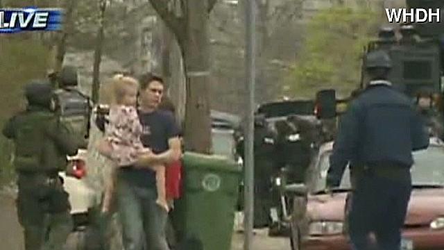 Armed police sweep Boston homes