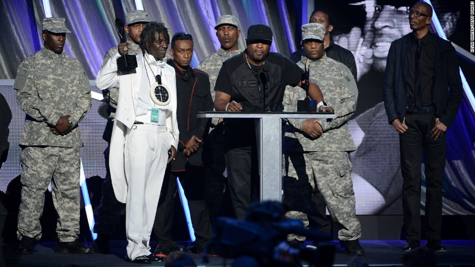 Public Enemy speaks onstage at the ceremony.