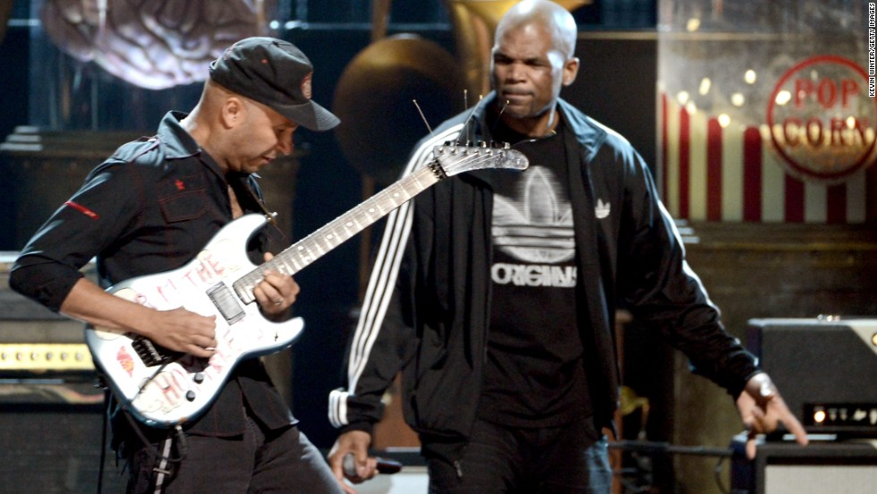 Rage Against the Machine guitarist Tom Morello, left, and Run-DMC's Darryl McDaniels perform onstage.