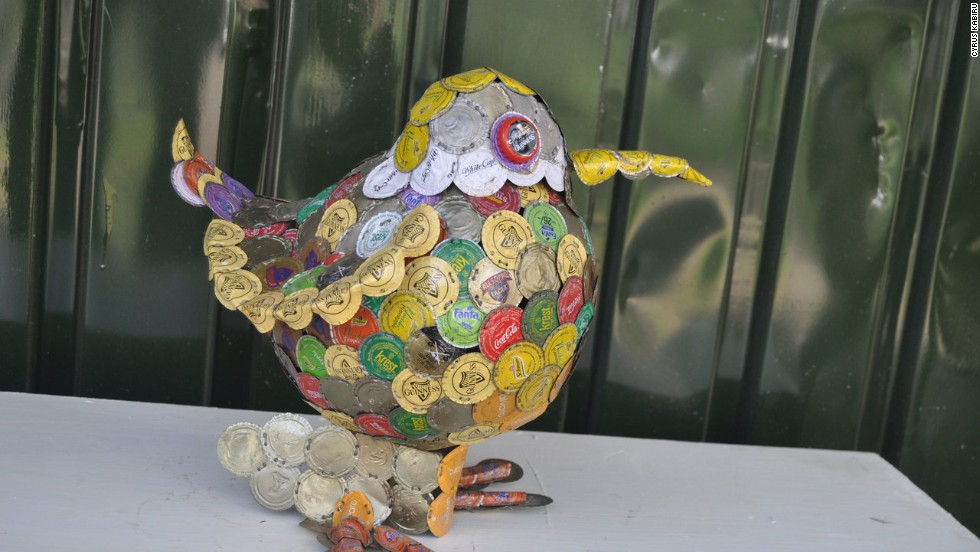 Apart from his arresting spectacles, Kabiru is also crafting sculptures from trash he collects. This piece is made from bottle tops.