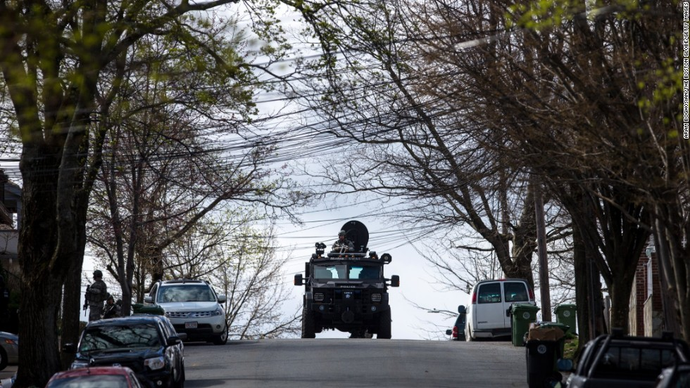 SWAT teams searches homes along Winsor Avenue in Watertown on April 19.