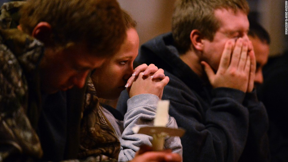 People pray during a candlelight vigil at St. Mary's Church on April 18.