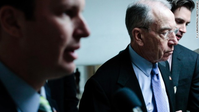 Sen. Chuck Grassley, right, said Friday that the suspects' background raises concerns about immigrant screening.