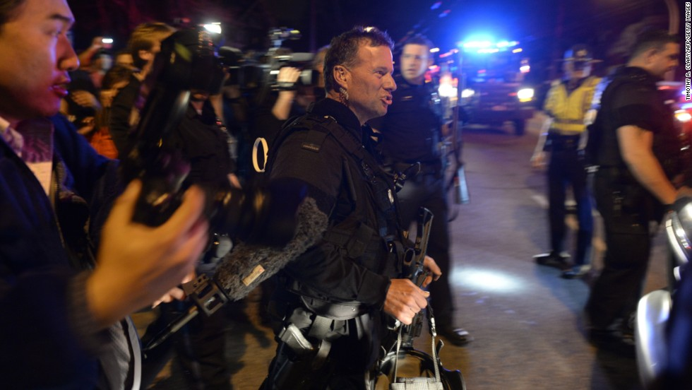Boston SWAT team members are surrounded by spectators and the media on April 19.