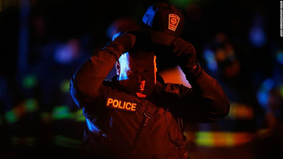 A police officer adjusts his hat while various law enforcement agencies descend on the area around Franklin Street on April 19.