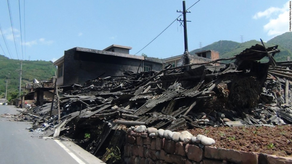 Houses collapsed on the side of a road in Sichuan province.