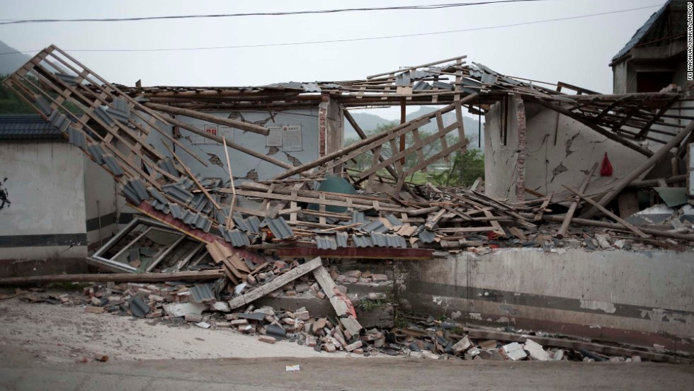 A collapsed house sits in Gucheng Village.