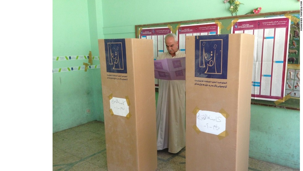 A man reviews his ballot on Saturday. Elections are being held in 12 of the 18 county's governorates. There has been concern that fears over security could affect the outcome of the vote.