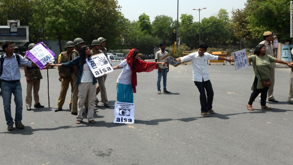Indian protesters stop traffic in front of police headquarters in New Delhi on Saturday, April 20.