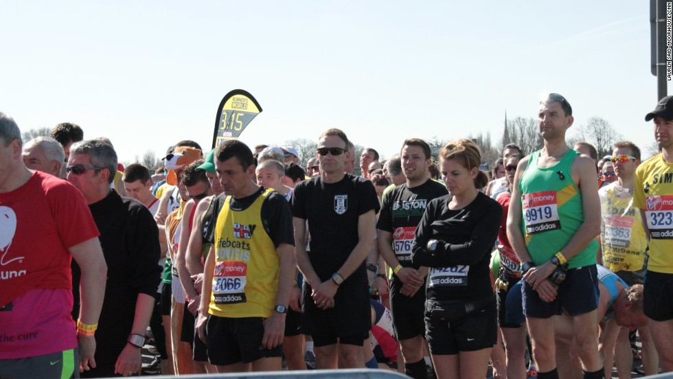 Athletes bow their heads at the start in Blackheath Common while observing the 30-second silence to remember those killed and injured by the blasts near the finish of the Boston Marathon on Monday.