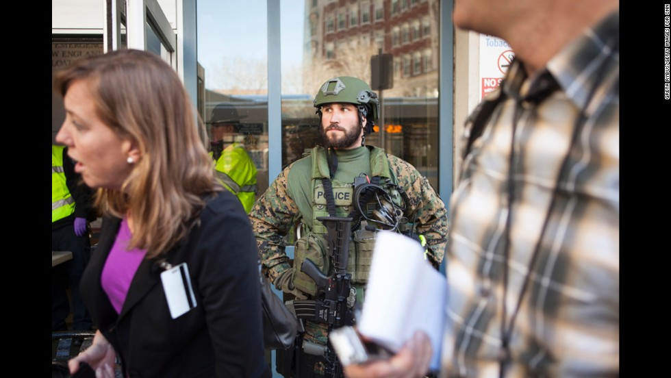 SWAT team member Scott Brooks guards the entrance of Tufts Medical Center, one of several hospitals that received patients after the Boston Marathon bombings on Monday, April 15.