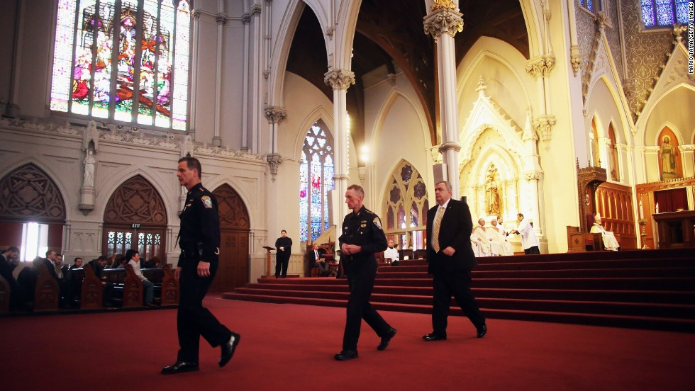 From left, Boston Police Department Superintendents Kevin Buckley and William Evans attend Mass with Police Commissioner Edward Davis on April 21, 2013.